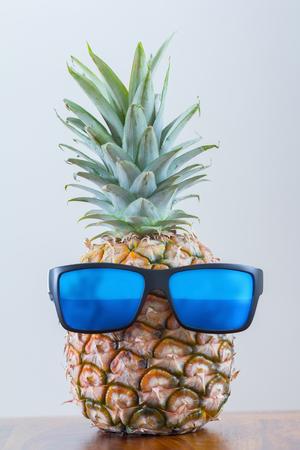 pineapple with sunglasses Standard-Bild