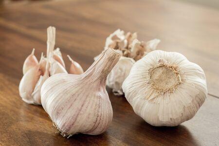 group of garlic bulbs on wood