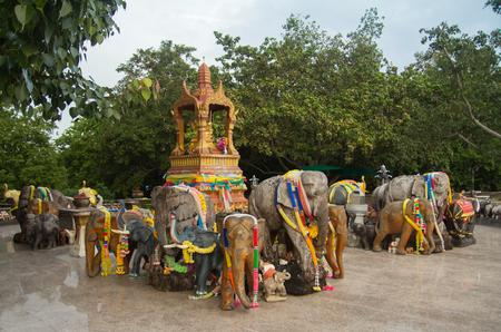 Decorated elephant statues surrounding Buddhist shrine in Asia