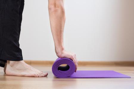 voeten en yoga mat Stockfoto