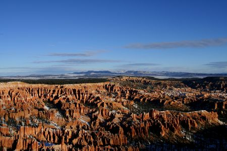 characteristic: A grand view of the whole Bryce Amphitheater with its characteristic hoodoos from Bryce Point in Bryce National Park.