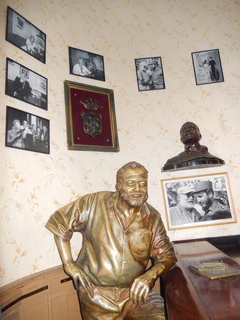 hemingway: Havana, Cuba - January 20, 2016: A life-size bronze statue of Ernest Hemingway, the Nobel Prize-winning American writer who used to go to the bar Floridita for cocktail daiquiri. This bar-restaurant is located in Calle Obispo in Old Havana, Cuba.