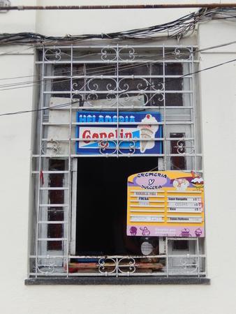 shop window: Havana, Cuba - February 1, 2016: Window with the manu of an ice-cream shop in Havana, Cuba.