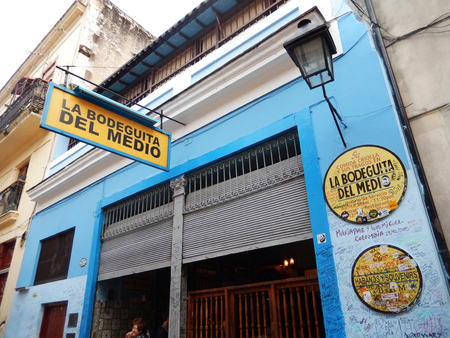 hemingway: Havana, Cuba - January 19, 2016: Restaurant-bar La Bodeguita del Medio is famous for its cocktail mojito. Inner and outer walls of Bodeguita are covered by signatures of famous and unknown customers from all over the world. This place is located near Hava