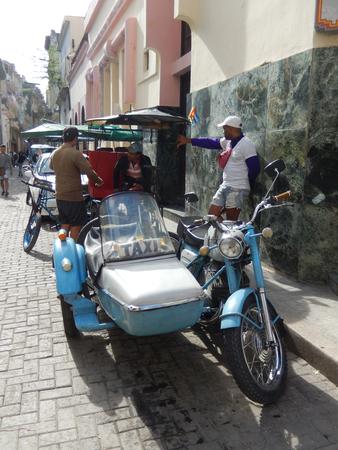 sidecar: Havana, Cuba - January 19, 2016: Cuban taxi drivers waiting for the clients in a street in Old Havana, Cuba.
