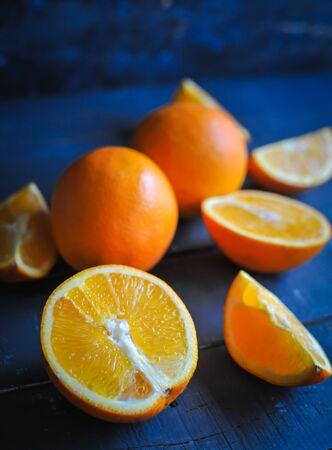 Close-up of fresh oranges on blue background Stock Photo
