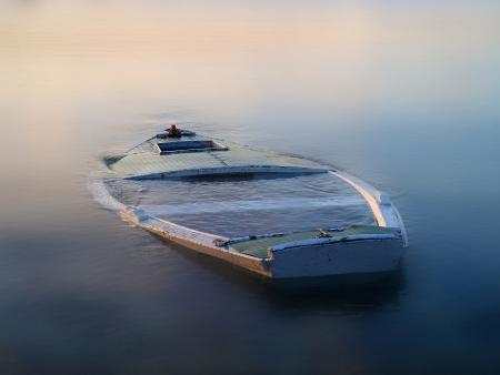 sinking boat in the fog