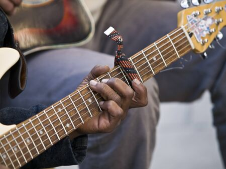 hand of guitar player on the street photo