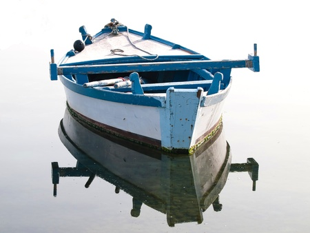 old wooden boat on the sea photo