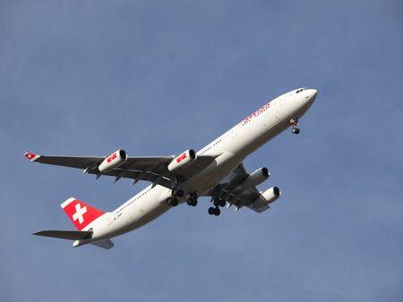 aeroplane fly on the blue sky