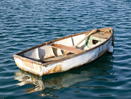 tethered: old wooden boat on the sea