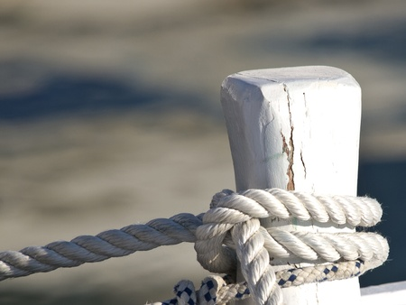 ropes on the boat docked in the harbour photo