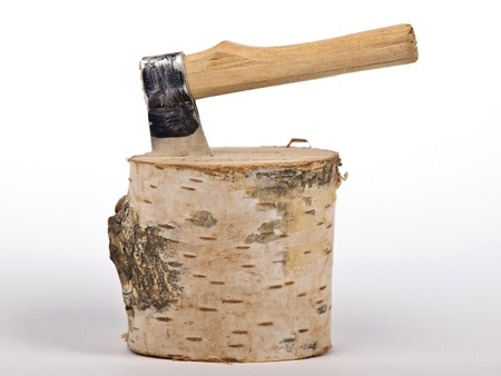 ax with handle stack in the chopped wood photo