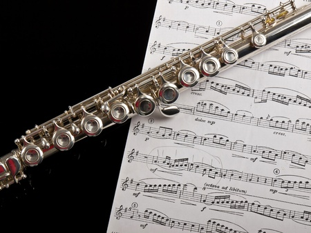 concert flute: flute and the sheet of notes