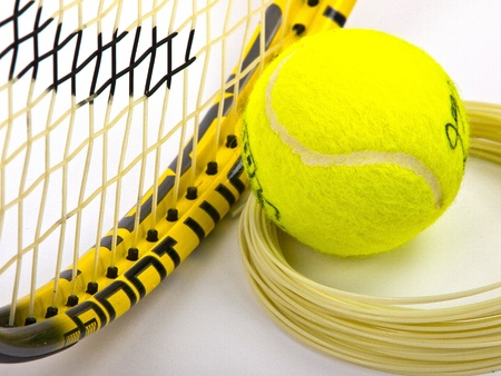 tennis racket string and yellow ball Stock Photo