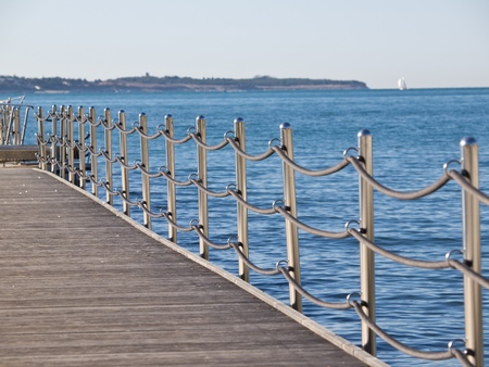 banister: stainless steel  fence with ropes on the sea