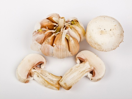 garlic and mushrooms on the table photo