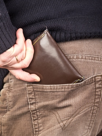 hand in pocket: hand taking wallet from the pocket Stock Photo