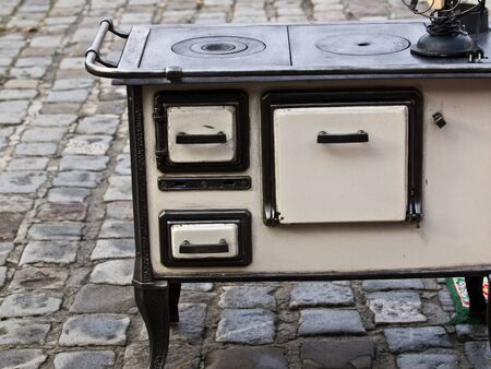 old cooking stove presented on the open market photo