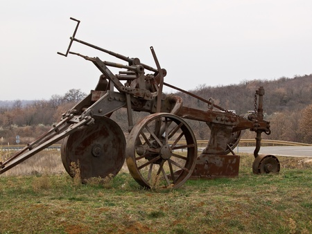 plough machine: old big rusty plough parked as a monument  Stock Photo