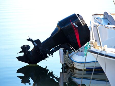 outboard engine on the sea boat photo
