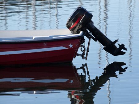 outboard engine on the plastic boat photo