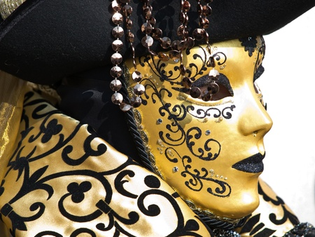golden mask on the piaca st Marco in Venice during the carnival photo
