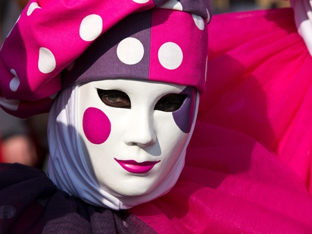 pink mask with spots on the carnival in Venice photo