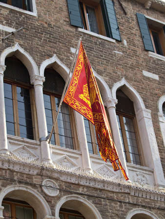 carnival flag on the plazza st Marco in Venice photo