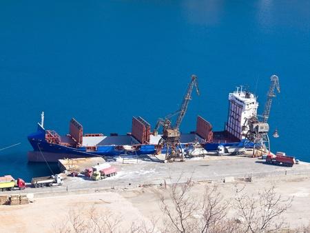 cargo ship loading on the dock photo