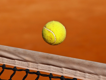 tennis ball fly over the net Stock Photo - 12787832