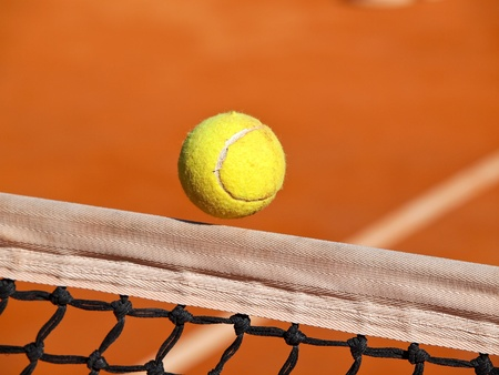 tennis ball over the net Stock Photo