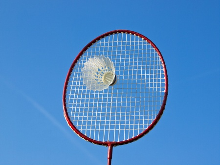 badminton racket and ball under the blue sky