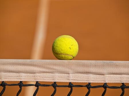 tennis ball ower the net Stock Photo - 13202835