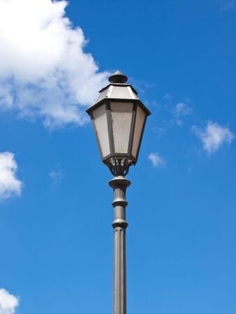 old iron street lamp on the blue sky Stock Photo - 13484851