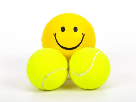 smiling tennis ball and two normal balls Stock Photo - 14965396