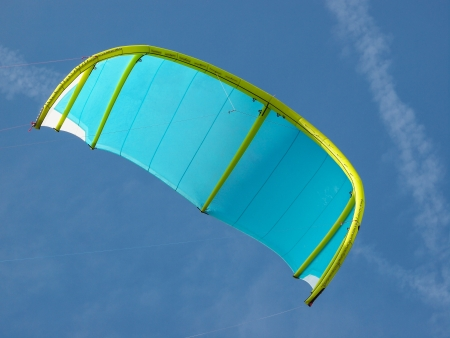 blue and green kite for kitesurfing in the sky photo