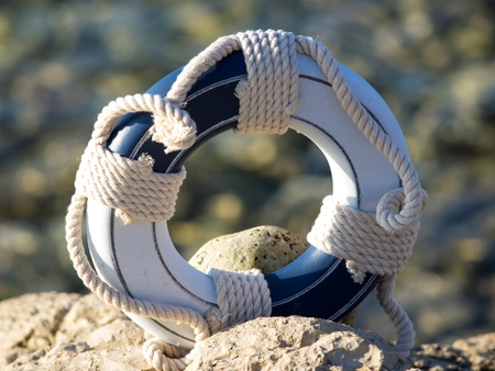 safe belt on the stone near the sea Stock Photo - 15414050