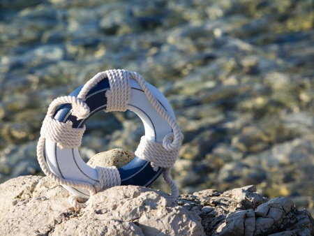 safe belt on the stone near the sea Stock Photo - 15414057