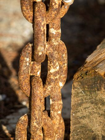 old red  rusty chain near the wooden plank Stock Photo - 15795858