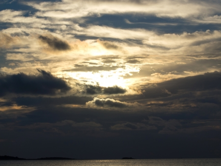 godlike: sunset on the sea just before the storm