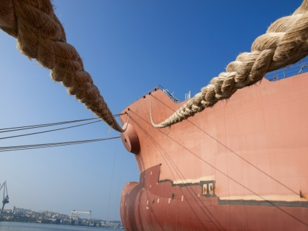 keel: ropes on the bow on a new ship in the shipyard Stock Photo