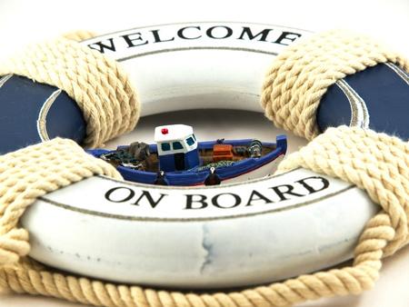 safe belt and boat isolated on white background Stock Photo - 16625658