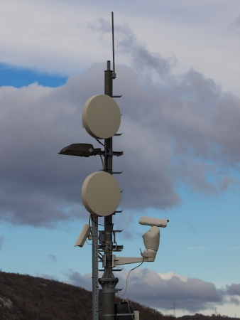 parabola: modern antenna with flat parabola on blue sky Stock Photo