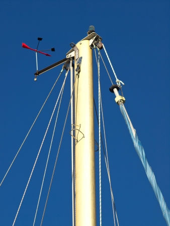 The top of a sailing ships mast against a blue sky Stock Photo - 17069132