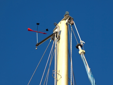 The top of a sailing ships mast against a blue sky Stock Photo - 17069126