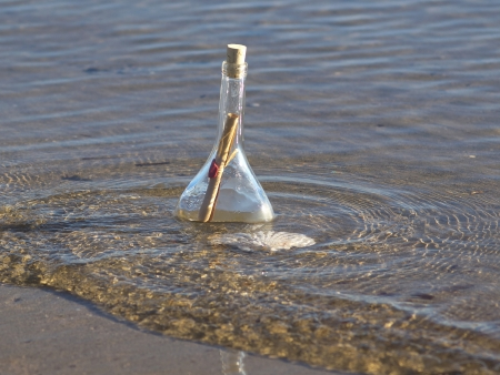 sealed message in the bottle on the sand beach Stock Photo - 17069987