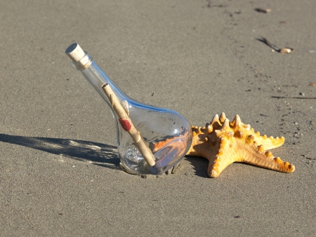 message in the bottle and starfish on the sand beach Stock Photo - 17116167