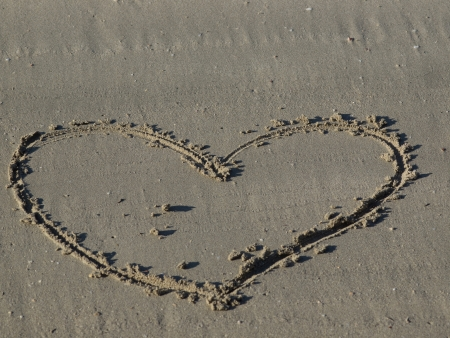 A heart shape drawn in the sand Stock Photo - 17225406