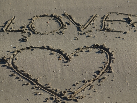 A heart shape drawn in the sand Stock Photo - 17225407